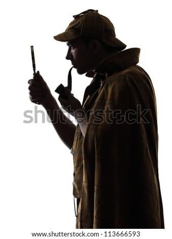 sherlock holmes silhouette in studio on white background - stock photo