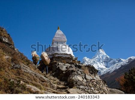 Sherpa work in Nepal - stock photo