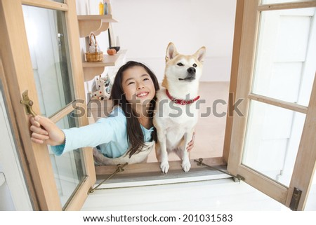 Shiba Inu and girls looking up at the sky - stock photo