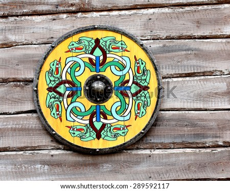 Shield on a wooden wall. decorative, design - stock photo