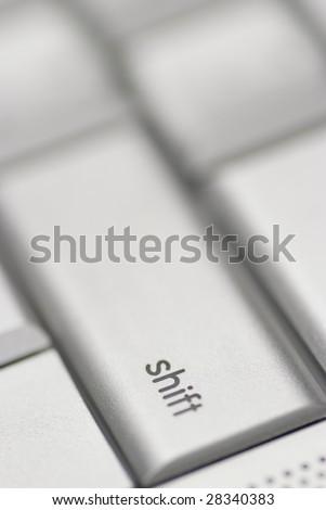 Shift button from a Mac keyboard - stock photo