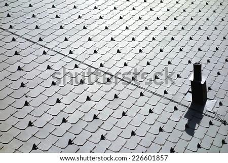Shingled roof surface - stock photo