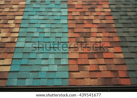 Shingles samples on roof - stock photo