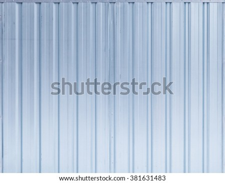 Shining blue ridged steel wall, background photo texture - stock photo