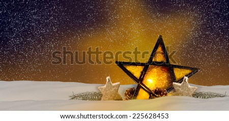 Shining Christmas star at night in the snow - stock photo