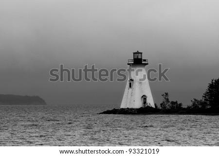 Shining lighthouse in B&W - stock photo