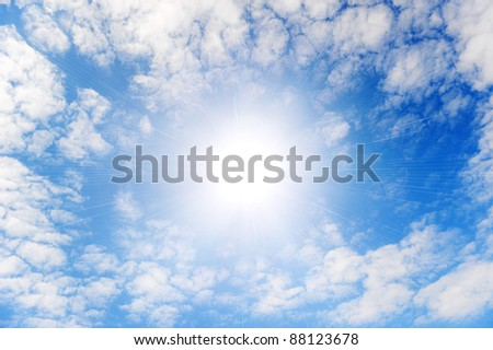 Shining sun with beams in the centre of clouds.Small wavy clouds - stock photo