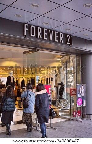 SHINJUKU, TOKYO - DECEMBER 27, 2014: Store front of Forever 21 fast fashion boutique in Shinjuku, Tokyo. Forever 21 is a international fashion chain and has about 500 branches internationally. - stock photo