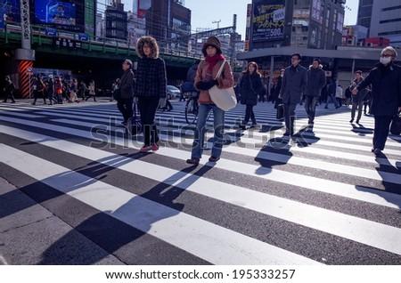 Shinjuku, Tokyo - December 17: Street view of Shinjuku. Shinjuku is a special ward located in Tokyo Metropolis, Population density of 17,140 people per km. December 17, 2013 in Tokyo, Japan. - stock photo