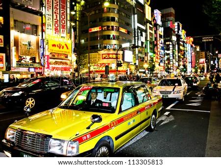 SHINJUKU, TOKYO - NOVEMBER 23:  The neon lights of Shinjuku are a major attraction in Tokyo on November 23, 2008 in Tokyo, Japan - stock photo