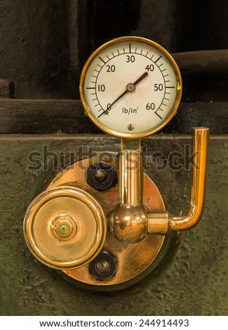 Shinny brass steam pressure gauge. - stock photo
