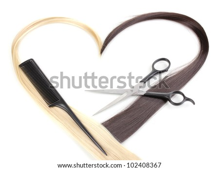 Shiny blond and brown hair with hair cutting shears and comb isolated on white - stock photo
