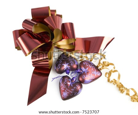 shiny bow and purple heart shaped Christmas globes - stock photo