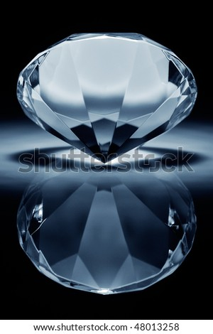 Shiny brilliant on a black reflective background - stock photo