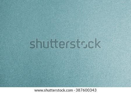 Shiny cool cyan silver blue color decorative texture paper: Bright brilliant festive glossy metallic look textured empty wallpaper backdrop: Aluminium tin metal material for craft design decoration - stock photo