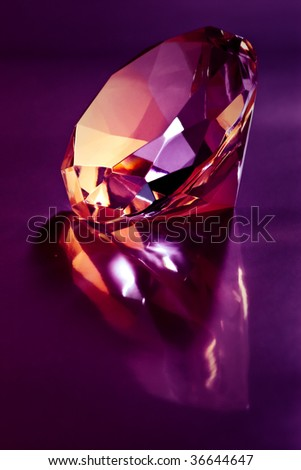 shiny diamond on purple light - stock photo