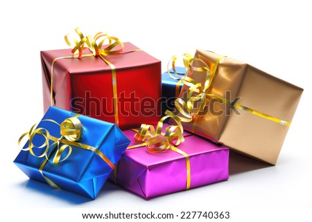 Shiny gift boxes on white background - stock photo