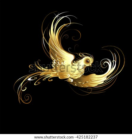 shiny, golden, artistically painted bird on a black background. Golden bird - stock photo