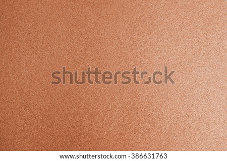 Shiny hot red copper bronze color decorative texture paper: Bright brilliant festive glossy metallic look textured empty wallpaper backdrop: Aluminium tin metal material for craft design decoration - stock photo