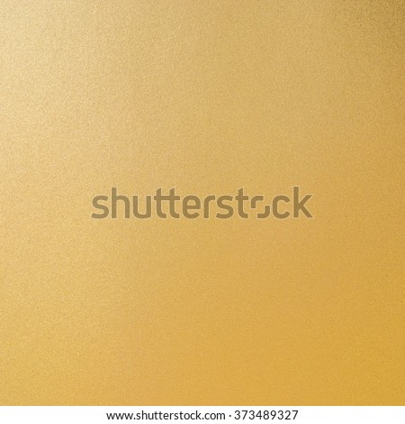 Shiny hot yellow gold foil leaf decorative texture background: Bright brilliant festive glossy metallic look textured backdrop: Aluminium tin metal like material surface for design decoration  - stock photo