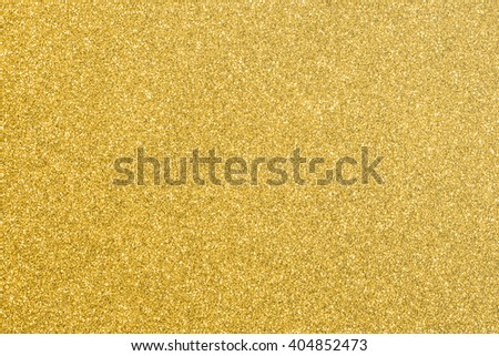 Shiny hot yellow gold golden color decorative texture paper: Bright brilliant festive glossy metallic look textured empty wallpaper backdrop: Aluminium tin metal material for craft design decoration - stock photo