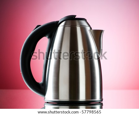Shiny kettle against the colorful gradient background - stock photo
