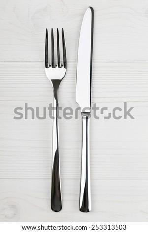 shiny knife and fork - stock photo