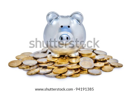 Shiny metal piggy bank on top of a pile of Euro coins. - stock photo