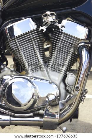 Shiny motorcycle engine with decoration - stock photo
