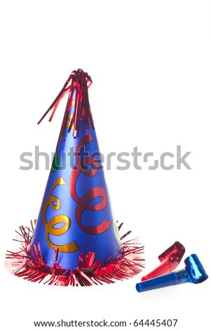 Shiny party hat and blowers on white background - stock photo