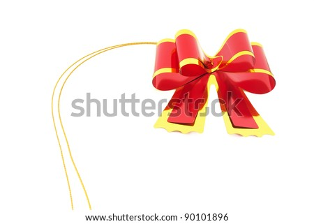 Shiny red and gold ribbon on white background - stock photo