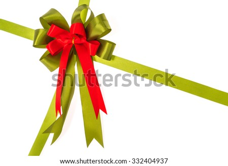 Shiny red and green ribbon on white background with copy space. - stock photo
