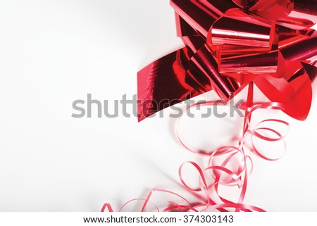 Shiny red ribbon on white background with copy space. Macro with shallow dof. - stock photo