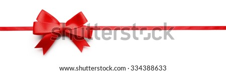 Shiny red ribbon with bow isolated on white - stock photo