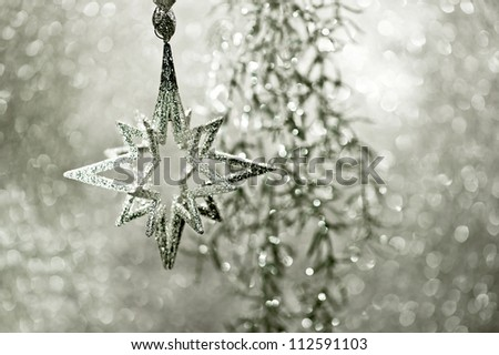 shiny silver star. christmas or new year decoration. abstract background. dark designed. selective focus - stock photo