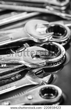 Shiny stainless steel tools, wrenches and ratchets - stock photo