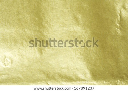 Shiny yellow gold foil abstract texture background - stock photo