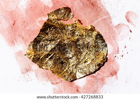 Shiny yellow gold foil on paper, abstract texture background - stock photo