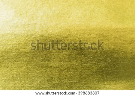 Shiny yellow gold paper foil decorative texture background: Bright brilliant festive glossy metallic look textured backdrop: Metal steel like material pattern surface arts crafts design decoration  - stock photo