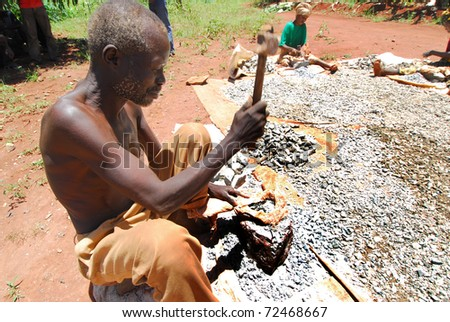 SHINYANGA, TANZANIA-MAR 18: Old miner quarries stones on March 18, 2010 in Shinyanga, Tanzania. Gravel quarries are sold for a dollar a day. To them it was the only occupation to feed their families - stock photo