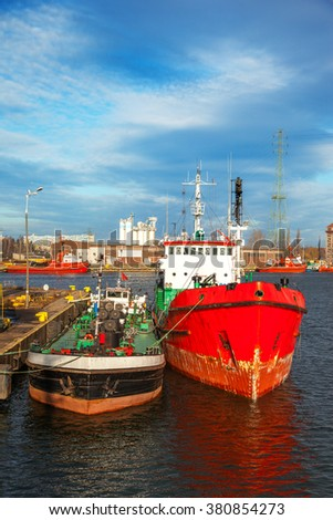 Ship and barge in port of Gdansk, Poland. - stock photo
