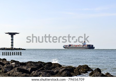 ship and container ship in harbor of rotterdam - stock photo
