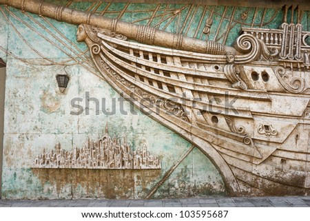 Ship and town on the wall, Brothers Grimm museum in Feodosiya - stock photo