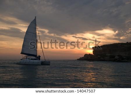 ship at sunset - stock photo