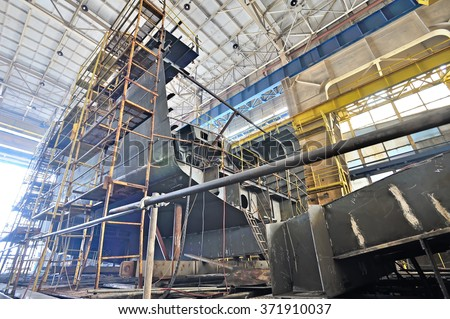 Ship building and scaffolding in a shipyard  - stock photo