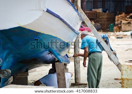 Ship building of new boards. boat building - stock photo