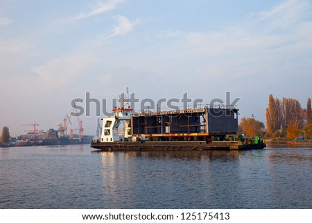 Ship carrying large steel components in shipyard Gdansk, Poland. - stock photo