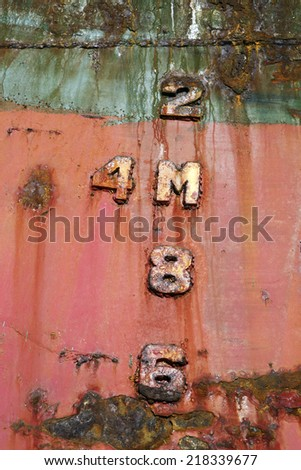 Ship depth markers on beached shipwreck - stock photo