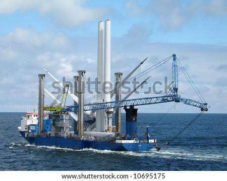 ship for offshore wind turbine installation - stock photo