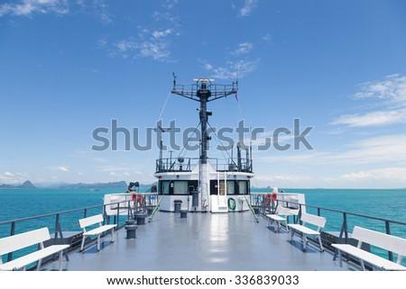 ship forecastle force Bright sky Boats travel across the vast island - stock photo